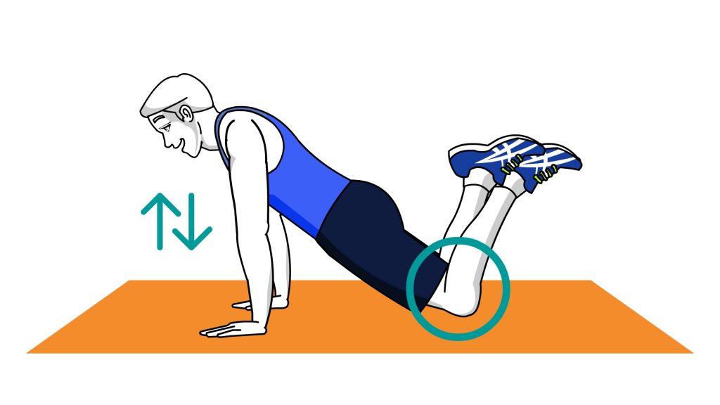 Flexão de braço com o apoio do joelho sobre o solo.